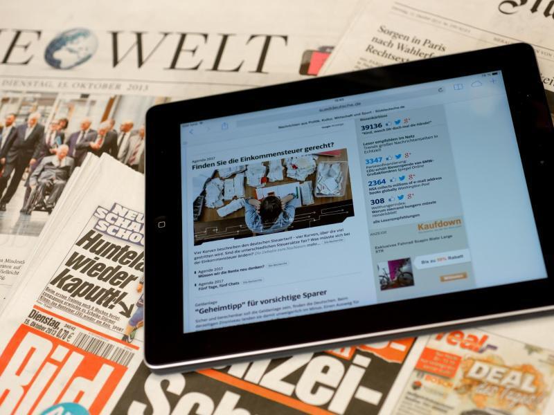 Bild zu Tablet auf Zeitungen