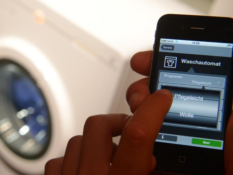 Bild zu Waschmaschine und Handy