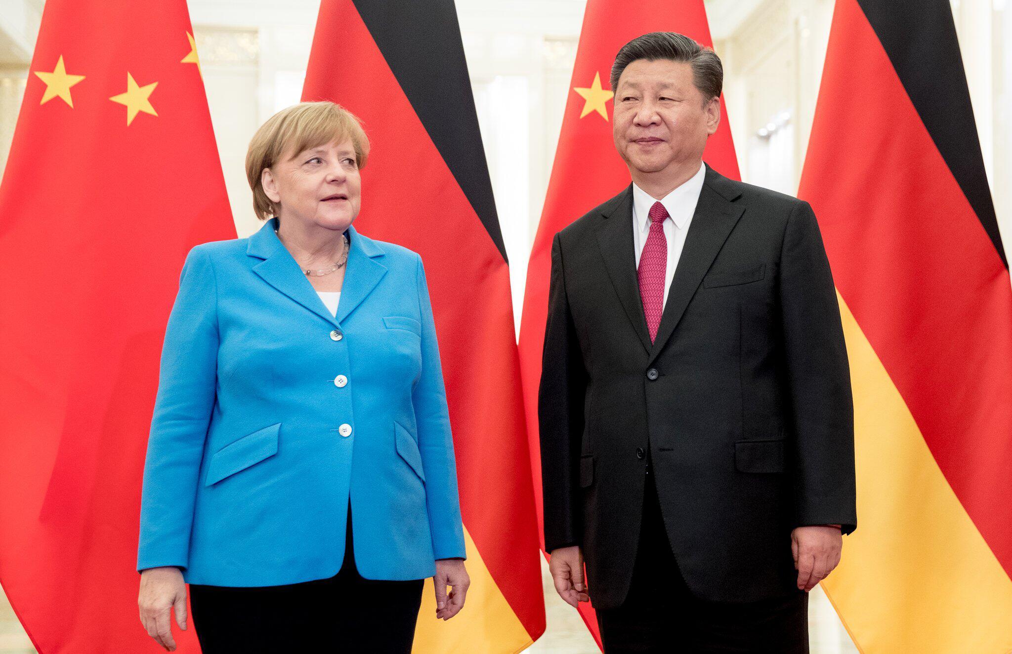 Bild zu Merkel und Xi Jinping