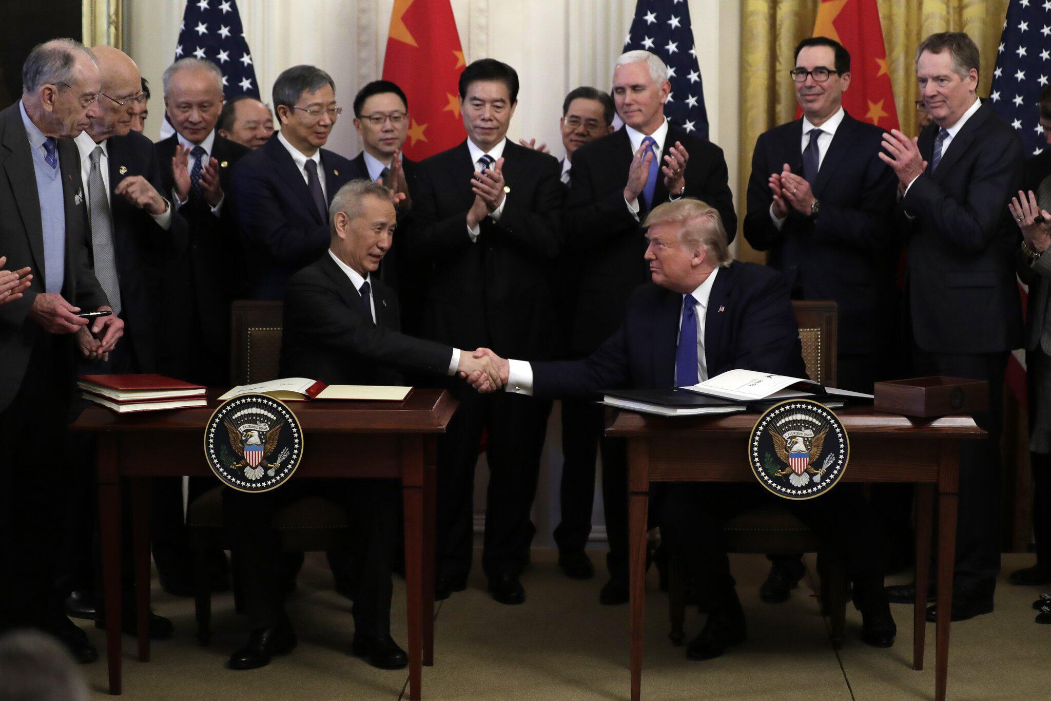 Bild zu USA und China unterzeichnen erstes Handelsabkommen